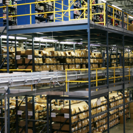 Conveyor Into Pick Module Supported by UNARCO Pallet Rack