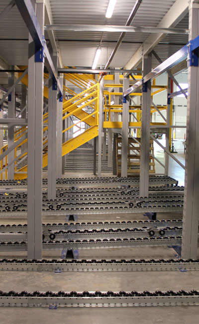 Pallet Flow Rack Pick Modules deliver pallets to concentrated work cells within a multi-level system that flow forward to worker positions for product breakdown.