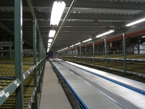 Gravity Flow Racks To Conveyor