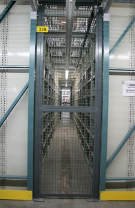 Shelving on Pick Module Level with Security Cage Door