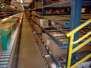 Gravity Racks To Conveyor With Boxes