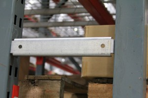 Row Spacer Attached to T-Bolt Pallet Rack